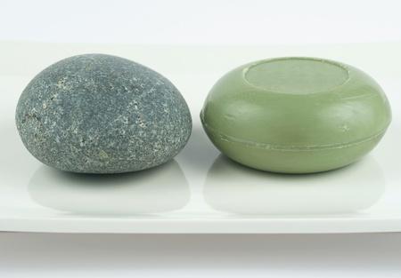 Green handmade soap and decorative stoone on white ceramic rectangular plate Stock Photo