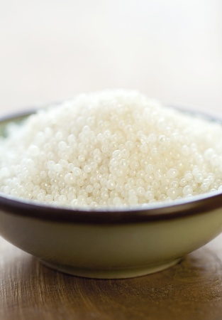 bath salt for spa in wooden plate on dark wooden table Stock Photo