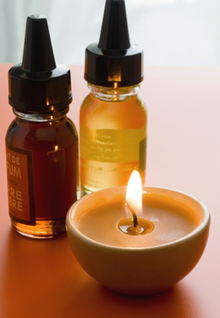 Special spa iols for aromatherapy and massage with relaxing candle near by Stock Photo