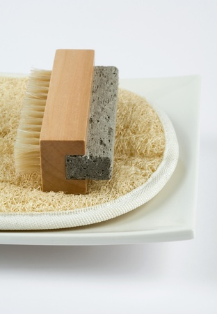 Bath equipment on square white plate, extreme close-up