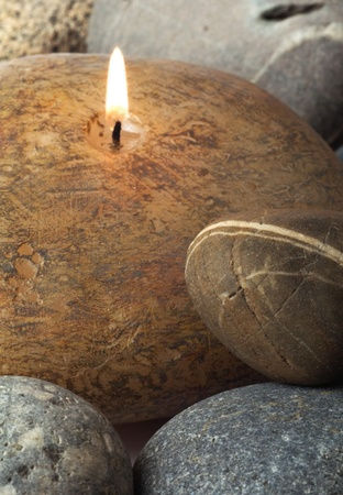 Candle camouflaged as polished rocks, very beautyfull desighn Stock Photo