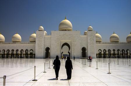 ABU DHABI, UAE-SEPTEMBER 1, 2015: Two women at Sheikh Zayed Mosque.
