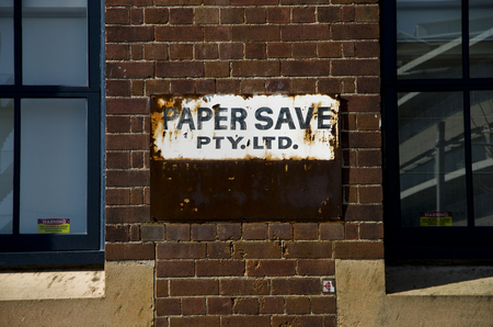 Old poster advertising Paper Save Factory in the Sydney Central Business District