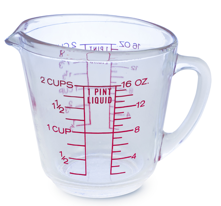 Empty measuring glass cup 1 Pint liquid on white background Фото со стока