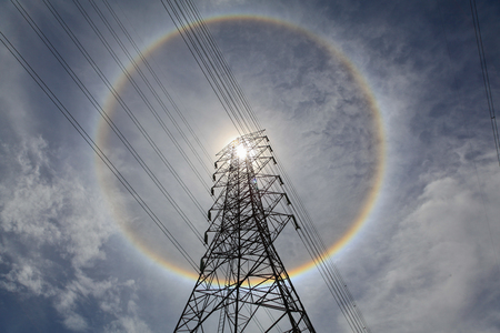 power line tower: High voltage power line tower with the sun hath acid. Stock Photo