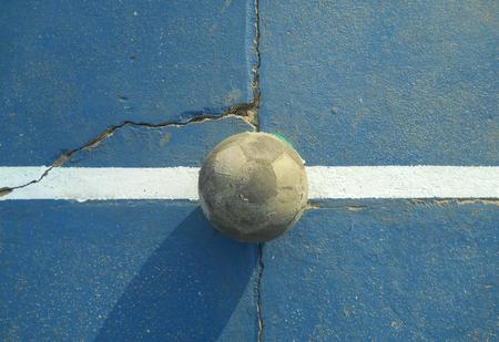 shape cub: Soccer ball on the cement floor