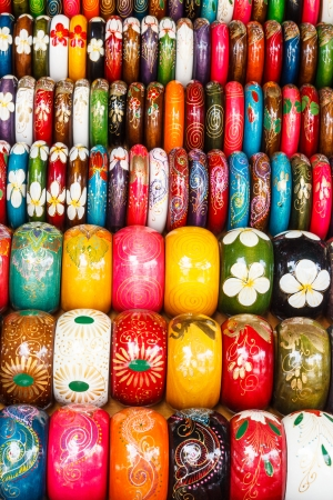 Rows of colorful wooden hand-painted bracelets