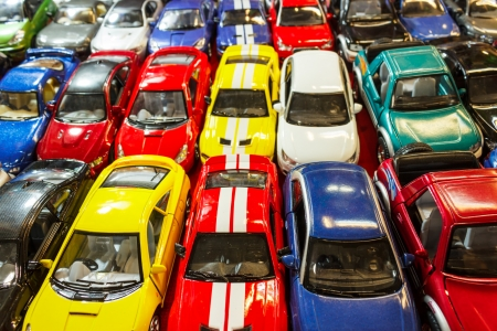 Many cars, toys outside, many colors Editorial