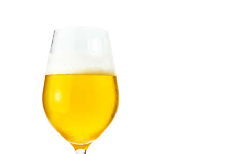 Closeup of beer in a glass , isolate on white background