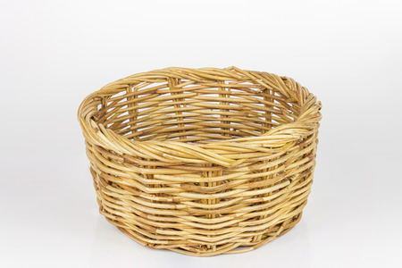 Brown wicker basket isolated on white background photo