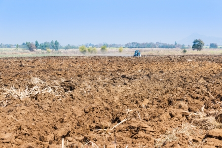 Plowing tractor working in field