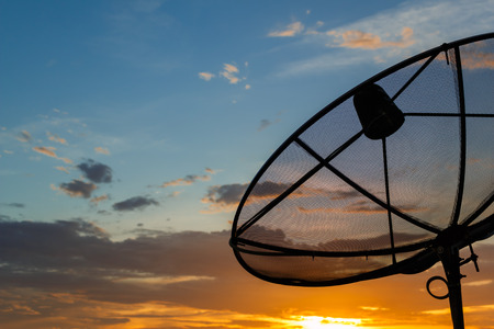 Satellite dishes on sunset Stock Photo