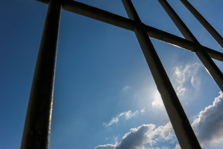 limbo: Prison bars and blue sky