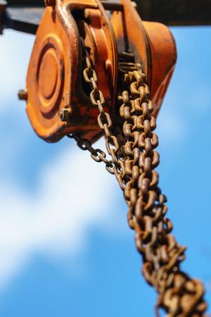 Industrial hook hanging on reel chain