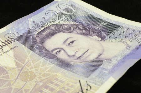 British twenty pound note on black background photo