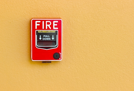fire break glass alarm  switch on the wall photo
