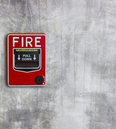 fire break glass on the concrete wall  background