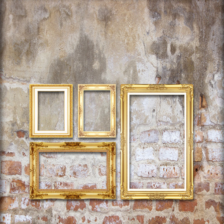 gold antique picture frame on the old brick wall background photo