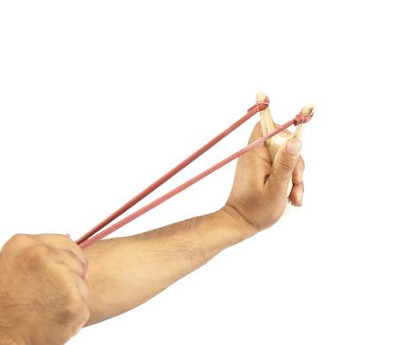 Hand Holding Aiming Slingshot photo