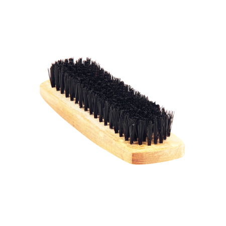 shoe brush on white background photo
