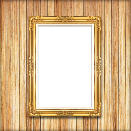golden frame on Wood wall background photo