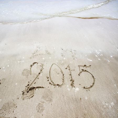 Year 2015 number written on sandy beach/New year 2015 background Archivio Fotografico