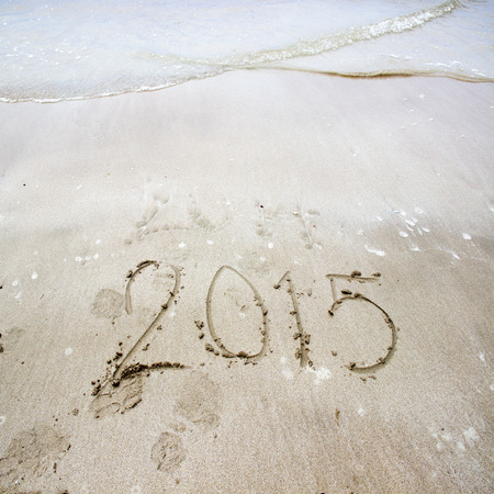 Year 2015 number written on sandy beachNew year 2015 background photo