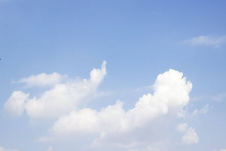 Blue sky and white clouds; Soft white clouds against blue sky photo