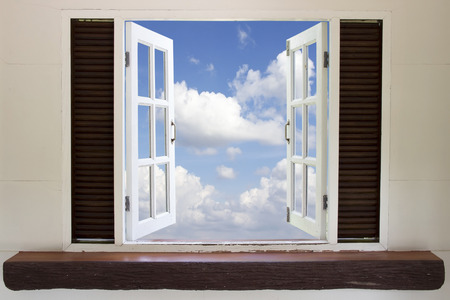 Open window in the sky,Open window against a wall the sky and cloud