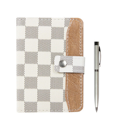 brown leather notebook with a pen on a white background ;Leather notebook and pen isolated on the white background photo