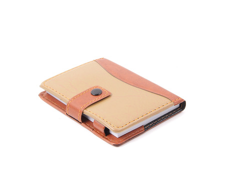 Portable notebook cover on white background photo