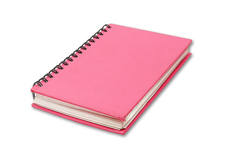 Red notebook on white background photo