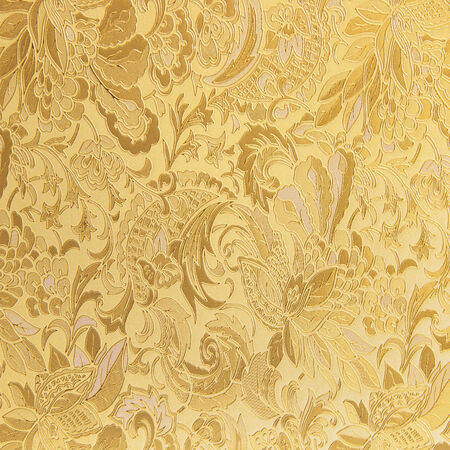 Golden floral ornament brocade textile pattern photo
