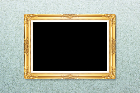 Empty golden vintage frame on wallpaper background photo