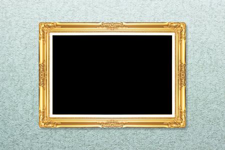 Empty golden vintage frame on wallpaper background photo