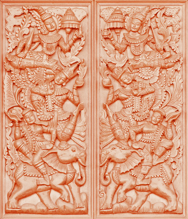woodcraft: Traditional Thai style wood carving on the wall of Temple in Thailand