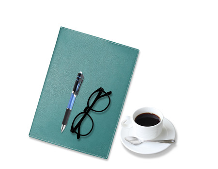 notebook with  coffee cup with pen and glasses on white background photo