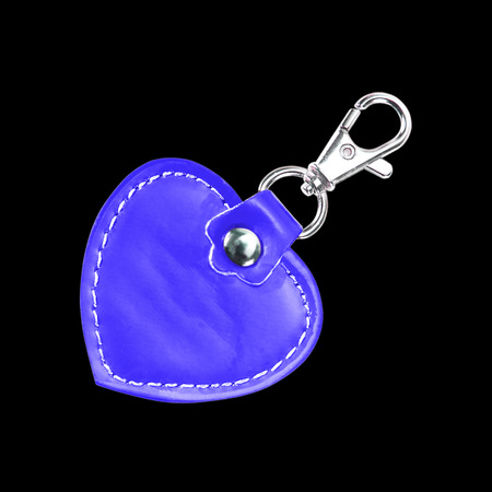 knickknack: Leather Round Keychain with clip lock for Key Isolated on black background