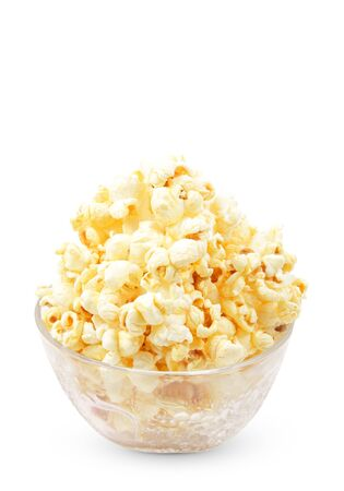popped: Glass bowl with popcorn on white background