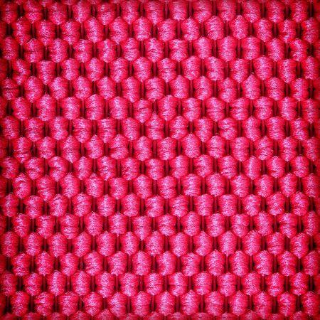 fiber: Red fiber textile background Stock Photo