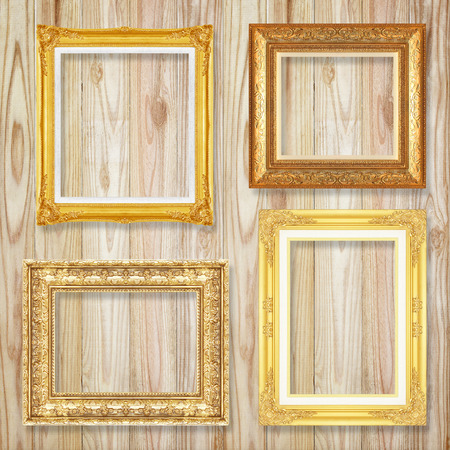 silver picture frame: The antique gold frame on wooden wall background
