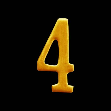 arabic number: The number four golden arabic  isolated on black background. Stock Photo