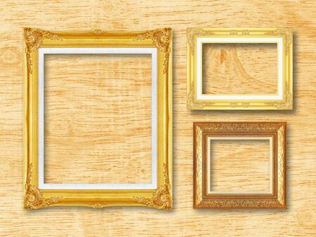 silver picture frame: The antique gold frame on wooden l background