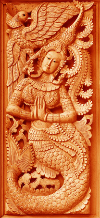 woodcraft: Traditional Old wood carving on the wall of Temple in Thailand,  Thai style Stock Photo
