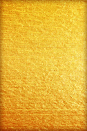 durability: Gold paint on cement wall texture. golden texture background Stock Photo