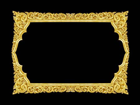 old decorative gold frame - handmade, engraved - isolated on black background Stock Photo