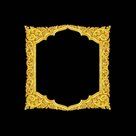 yellow tacks: old decorative gold frame - handmade, engraved - isolated on black background Stock Photo