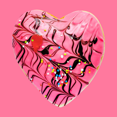 Heart shaped donut isolated on pink background Stock Photo