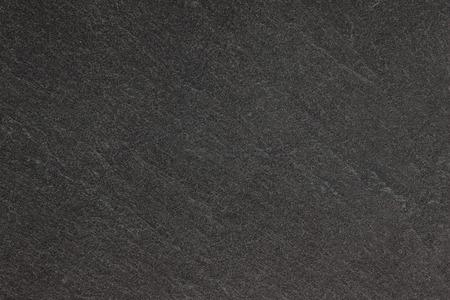 Donkergrijze zwarte leiachtergrond of textuur. Stockfoto