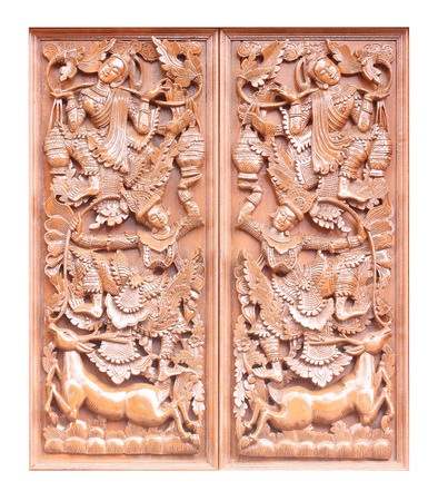 Traditional Old wood carving on the wall of Temple in Thailand,  Thai style Standard-Bild